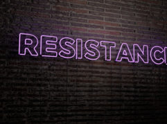 RESISTANCE -Realistic Neon Sign on Brick Wall background - 3D rendered royalty free stock image. Can be used for online banner ads and direct mailers.